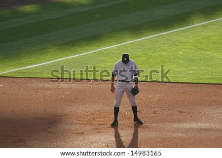 DENVER - JUNE 19: Alex Rodriguez, third baseman for the New York Yankees, bows his head before the game with the Colorado Rockies at Coors Field, June 19, 2007 in Denver, Colorado. - stock photo