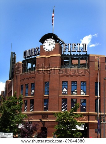 DENVER - JUNE 29: Coors Field, with its hand-laid brick facade and clock tower, is home to the Colorado Rockies.  Fans meet at this spot before a game against the Astros on June 29, 2005 in Denver, CO