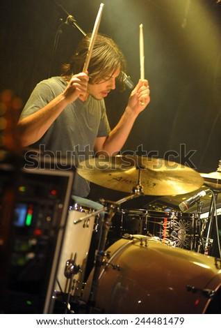 DENVERJUNE 26:Drummer Walker Adams of the Rock band Miggs performs in concert June 26, 2014 at the venue Eck's  in Denver, CO. - stock photo
