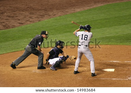 DENVER - JUNE 19: Johnny Damon, New York Yankees outfielder, at bat during the game with the Colorado Rockies at Coors Field, June 19, 2007 in Denver, Colorado. - stock photo