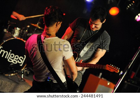 DENVERJUNE 26:Vocalist/Guitarist Don Miggs and Guitarist John Luzzi of the Rock band Miggs perform in concert June 26, 2014 at the venue Eck's  in Denver, CO. - stock photo