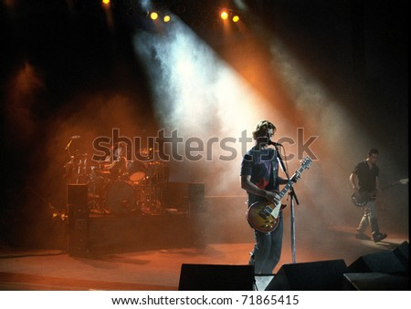 DENVER-MAY 6: Gavin Rossdale, vocalist & guitarist of the alternative rock band Bush, performs in concert May 6, 2000 at Red Rocks Amphitheater in Denver, CO. - stock photo