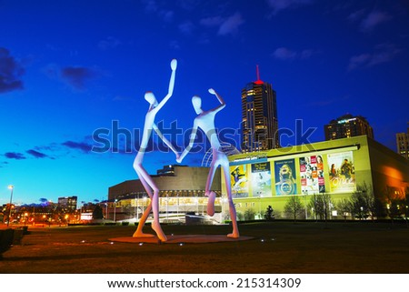 DENVER - May 1, 2014: The Dancers public sculpture at night time on May 1, 2014 in Denver, Colorado. The Dancers was permanently installed in front of the Denver Performing Arts Complex in 2003. - stock photo