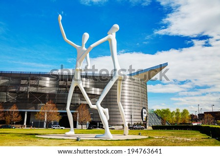 DENVER - May 1, 2014: The Dancers public sculpture on May 1, 2014 in Denver, Colorado. The Dancers was permanently installed in front of the Denver Performing Arts Complex on June 12, 2003. - stock photo