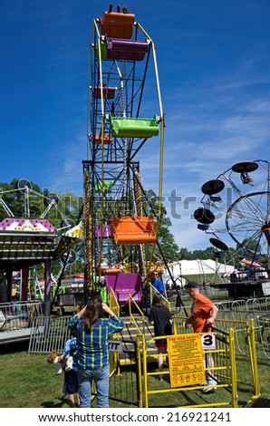 DENVER, PA, USA-SEPTEMBER 12, 2014:  Carnivals and country fairs are in full swing. They are common in late summer and early fall and include exhibits, food, rides, and entertainment for all ages. - stock photo