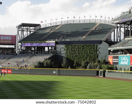 DENVER - SEPTEMBER 30: Rock Pile fan section at Coors Field, home ballpark of the Colorado Rockies, on September 30, 2009 in Denver. The stadium opened in 1995 in Denver's lower downtown district. - stock photo