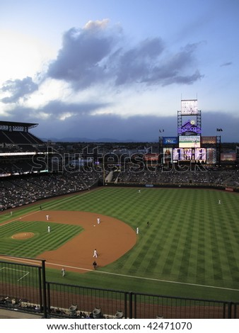 DENVER - SEPTEMBER 30: Scenic Coors Field, home ballpark of the Colorado Rockies, with a view of the Rocky Mountains before a baseball game September 30, 2009 in Denver. - stock photo