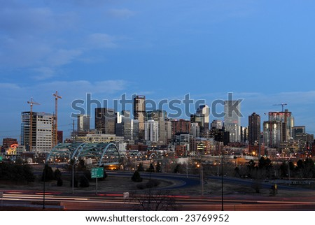 Denver skyline at dusk, rush hour - stock photo
