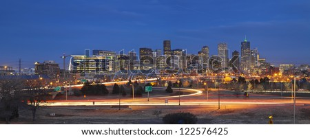 Denver Skyline. Panoramic image of Denver skyline and busy highway in the foreground. - stock photo