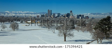 Denver Skyline With Snow Covered City Park From Denver Museum of Nature and Science - stock photo