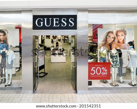 DENVER, USA - JUNE 25, 2014: Detail of the Guess store in Denver. Guess is  American upscale clothing line brand founded at 1981 and have more than 480 shops worldwide.
