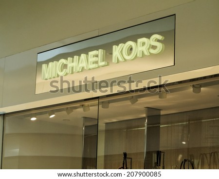 DENVER, USA - JUNE 25, 2014: View at Michael Kors shop in Denver. Michael Kors  is a New York City-based fashion designer widely known for designing classic American sportswear for women.