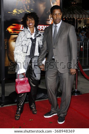 "Denzel Washington and Pauletta Washington at the Los Angeles Premiere of ""Unstoppable"" held at the Westwood Village Theater in Hollywood, California, United States on October 26, 2010.  - stock photo"
