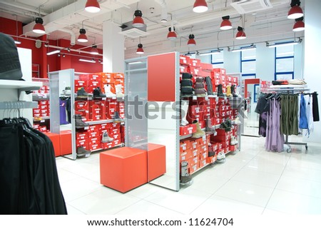 department of outer clothing and foot-wear in store - stock photo