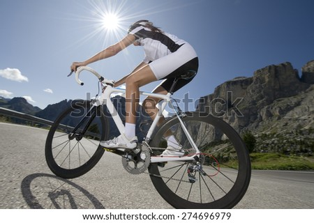 departure from racing driver in the beautiful weather in the Dolomites  - stock photo