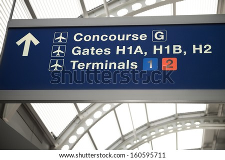 departure gates and terminal sign - stock photo