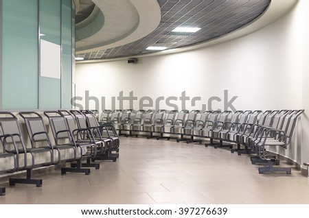 departure lounge in an airport with chairs. Round galary.  Airport Pulkovo, Russia.