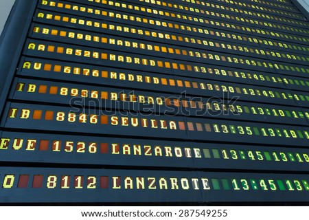 Departure schedule at an airport in Spain - stock photo