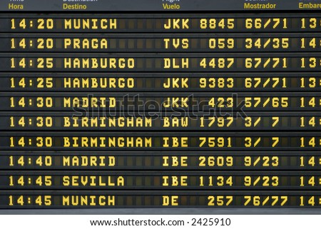 departure timetable at the barcelona airport - stock photo