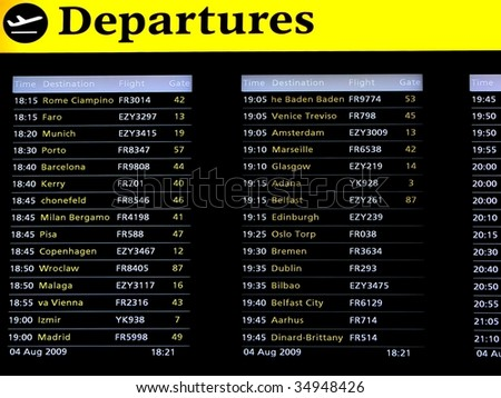 Departures Board on Airport - stock photo