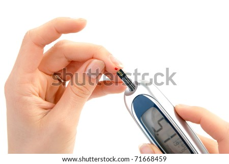 Dependent first type Diabetic patient measuring glucose level blood test using ultra mini glucometer and small drop of blood from finger and test strips isolated on a white background - stock photo