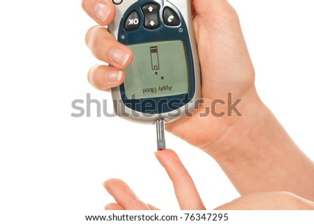 Dependent first type Diabetic patient measuring glucose level blood test using ultra smart sugar glucometer and small drop of blood from finger and test strips isolated on a white background - stock photo