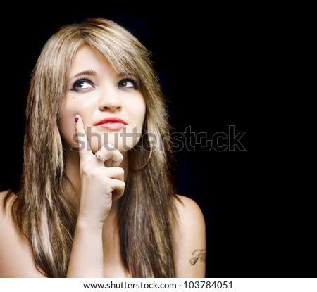 Depiction of a business innovative solution with a closeup portrait of a beautiful girl gesturing an idea with hand to face, isolated on black background with copyspace - stock photo