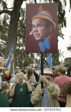 Depiction of President George W. Bush as Pinocchio painted on a sign at an anti-Iraq War protest march in Santa Barbara, California on March 17, 2007 - stock photo