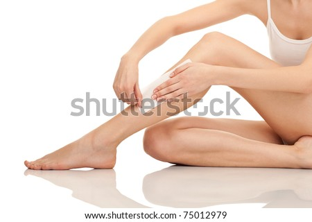 depilation female legs with waxing, isolated on white background - stock photo