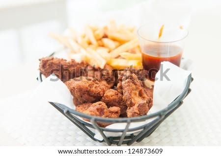 depp fried chicken tenders or strips with crispy french fries and bbq dipping sauce - stock photo