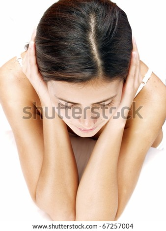 Deppresed woman on white background.  Young latin woman in privacy, - stock photo