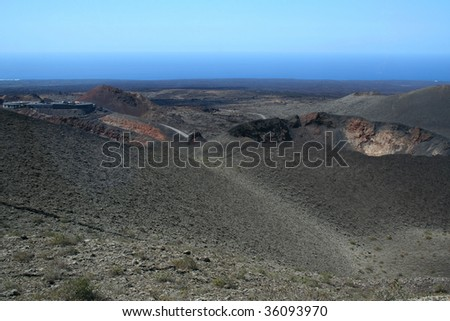 deppresive dark landscape - National Park Timanfaya, island Lanzarotte, Spain, Europe - stock photo