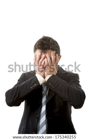 depressed and frustrated business man in financial crisis covering his face with his hands on white background with copy space - stock photo