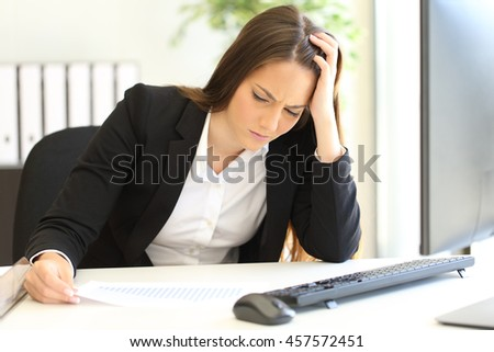 Depressed and ruined businesswoman looking at negative growing graphic after bankruptcy - stock photo