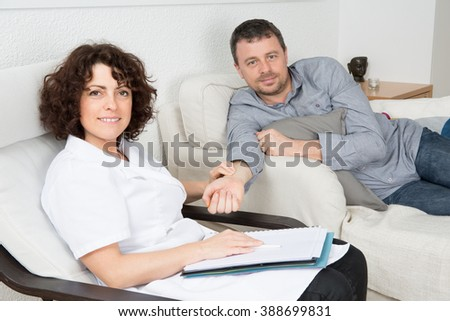 Depressed AND SAD middle aged man in session with therapist - stock photo