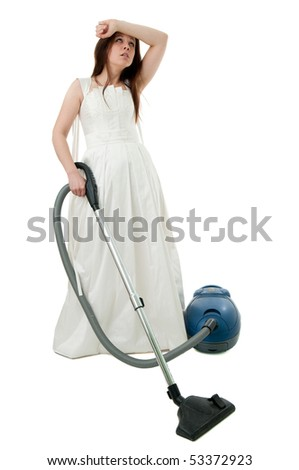 depressed bride with vacuum cleaner,  isolated picture on the white background - stock photo