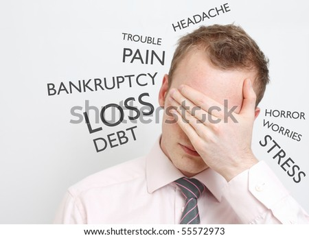 Depressed business man - stock photo