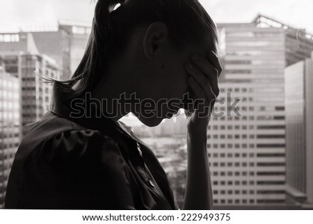 Depressed business woman - stock photo