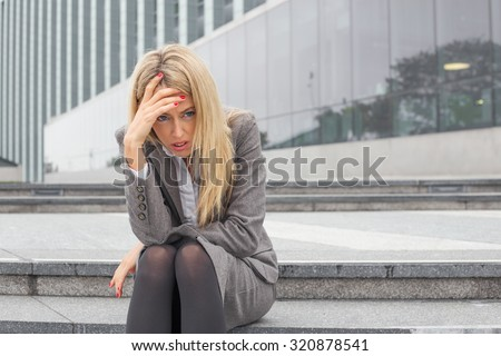 Depressed business woman - stock photo
