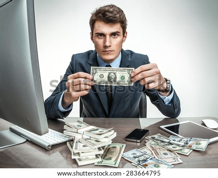 Depressed businessman dissatisfied with his earnings, profit, income, earnings, gain, benefit, margin / modern office man at working place, depression and crisis concept - stock photo