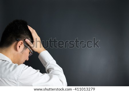 Depressed businessman holding his head in his hands