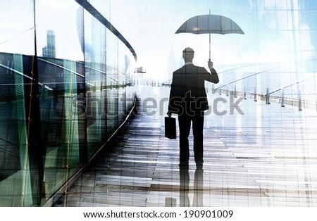 Depressed Businessman Standing While Holding an Umbrella - stock photo