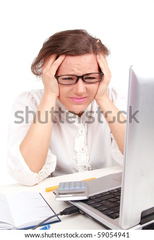 Depressed businesswoman holding her head, sitting in office