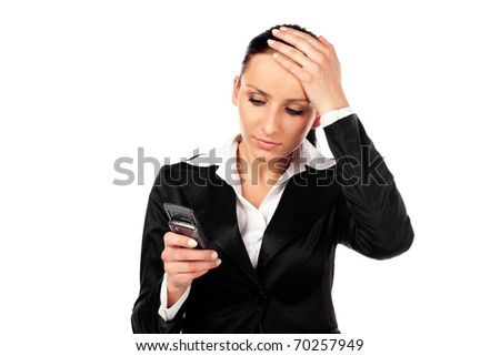 Depressed businesswoman reads the message on cellphone. Isolated on white background - stock photo