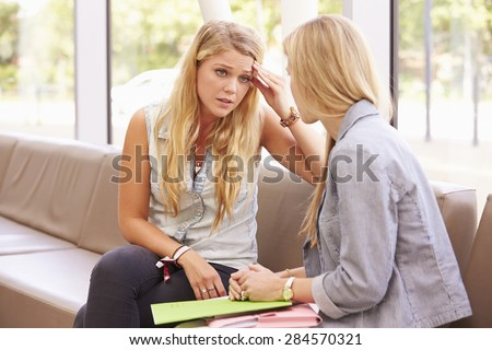 Depressed College Student Talking To Counselor - stock photo