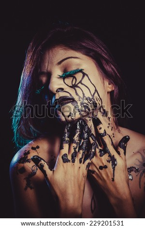 depressed concept, crying woman with tears and makeup dark light - stock photo