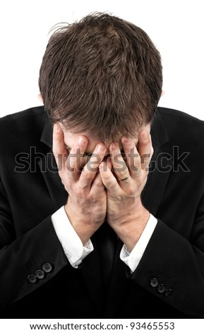 Depressed exhausted businessman covering his face by hands