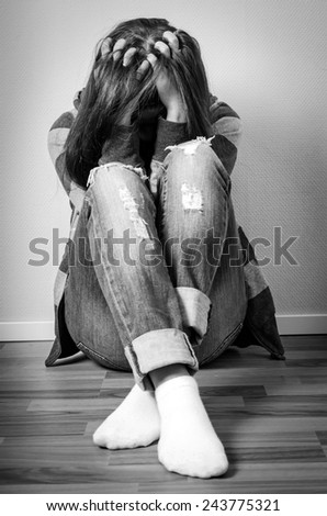Depressed girl hiding face - stock photo