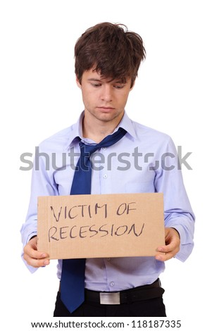 Depressed jobless young businessman holding a cardboard: victim of recession, isolated on white background - stock photo
