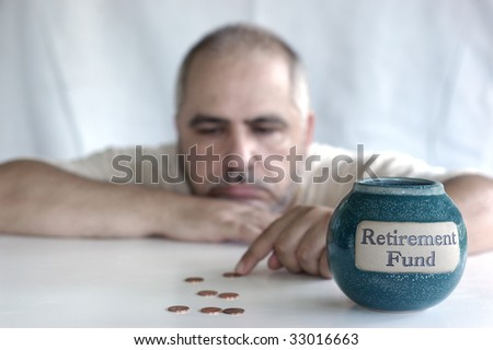 depressed man counting pennies from retirement fund - stock photo